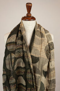 Létol French organic cotton scarf with a geometric print of circles and stripes in tones of olive, khaki, coffee and taupe.