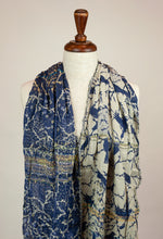 Load image into Gallery viewer, Létol French organic cotton scarf with tree print, featuring birds and a floral border in oatmeal and blue with gold highlights.