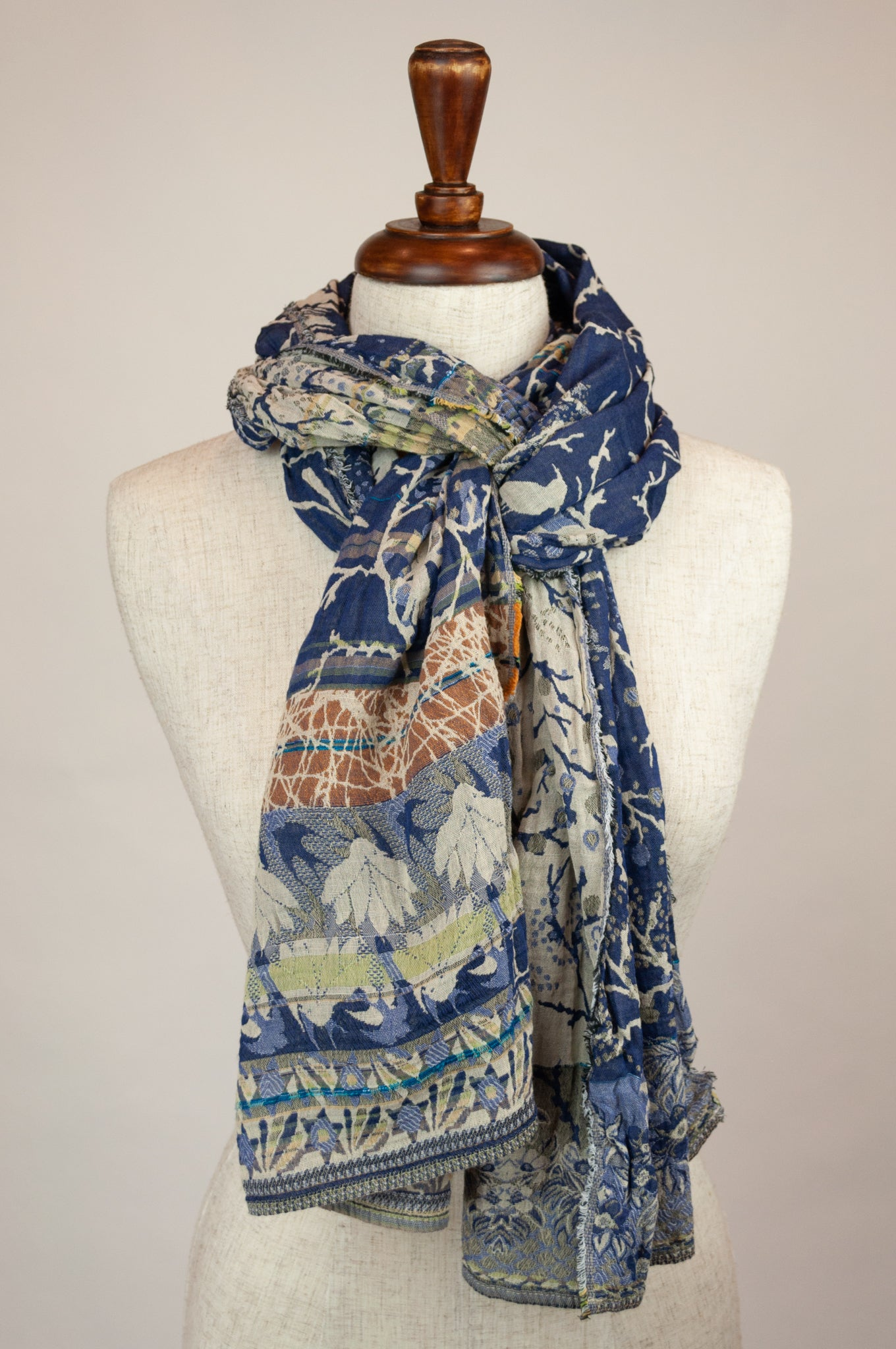 Létol French organic cotton scarf with tree print, featuring birds and a floral border in oatmeal and blue with gold highlights.