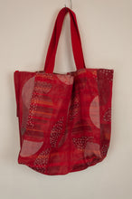Load image into Gallery viewer, French market bag, reversible tote made from organic cotton in jacquard weave, red and coral geometric circle and stripes pattern, with red and white bird print on reverse.