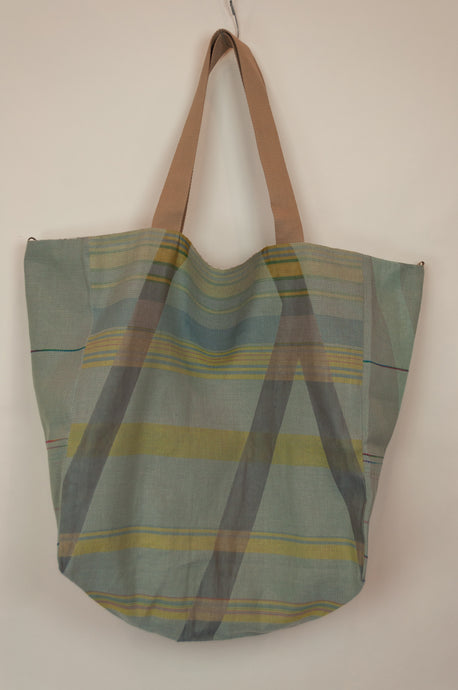 French market bag, reversible tote made from organic cotton in jacquard weave with geometric aqua stripe pattern.