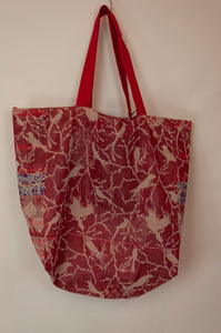 French market bag, reversible tote made from organic cotton in jacquard weave, red and coral geometric circle and stripes pattern, with red and white bird print on reverse.
