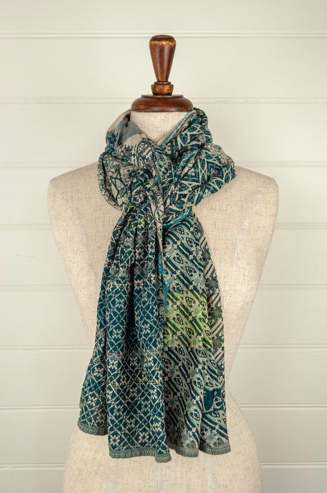 Létol French organic cotton scarf, patterned in shades of green with oatmeal accents.