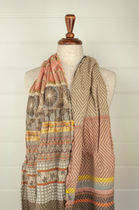 Létol French organic cotton scarf with a graphic stripe design in autumn tones of peach, paprika, lemon, coffee and taupe.