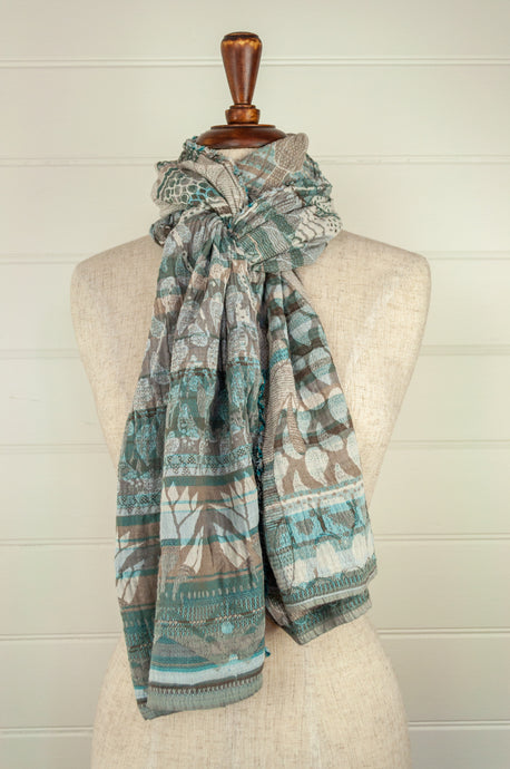 Létol French organic cotton scarf with a striped and floral design in tones of aqua, taupe and white.