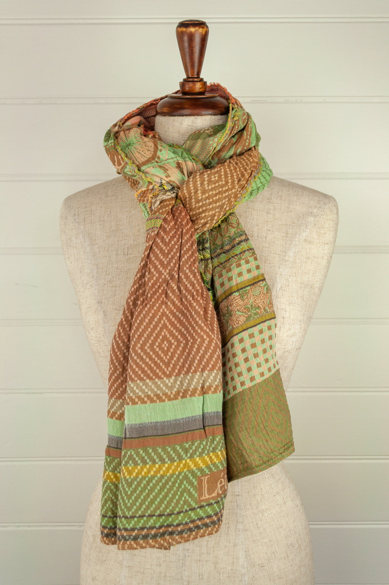 Létol French organic cotton scarf with a graphic stripe design in autumn tones of pistachio, lemon, coffee and rose pink.