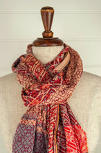Load image into Gallery viewer, Létol French organic cotton scarf, patterned in shades of red with grey accents.