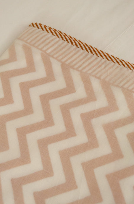 Soft cotton muslin layered Queen King bed quilt summer blanket in white and mustard chevron pattern.