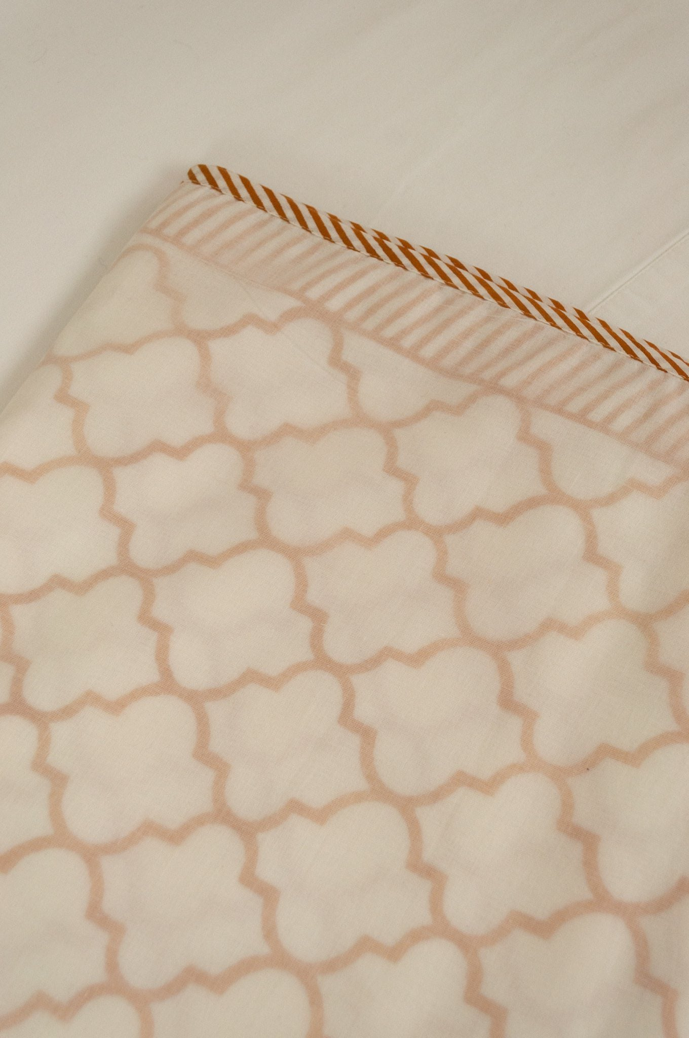 Soft cotton muslin layered dohar Queen King size bed quilt blankets, mustard tile pattern with stripe border.