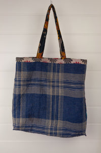 Vintage kantha tote bag, made from recycled cotton saris, in black, white and red, blue check reverse.