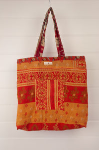 Vintage kantha tote bag, made from recycled cotton saris, in orange, red and black, gold stripe interior.