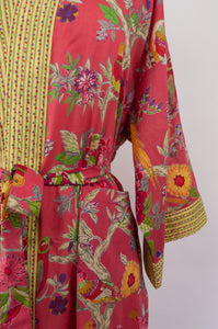 Cotton voile kimono robe dressing gown in coral bird print with yellow trim, close up.