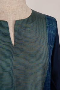 Pure silk shibori dyed kurta top with an indigo base and highlights in brighter blues and deep sage, neck detail.
