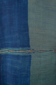 Pure silk shibori dyed kurta top with an indigo base and highlights in brighter blues and deep sage, fabric detail.