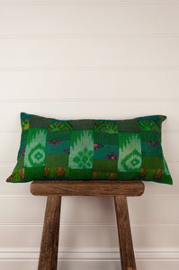 Vintage silk patchwork kantha bolster cushion, 30cmx60cm, in shades of emerald green, with ikat pieces and highlights of royal purple.
