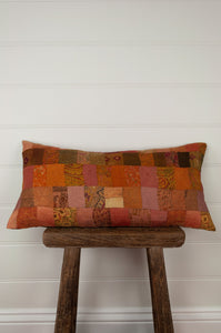 Vintage silk kantha cushion is in rich autumnal tones of orange, terracotta and vintage rose.
