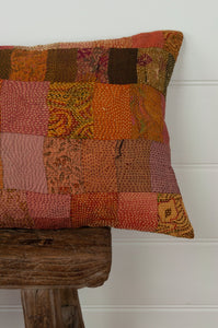 Vintage silk kantha cushion is in rich autumnal tones of orange, terracotta and vintage rose. Close up.