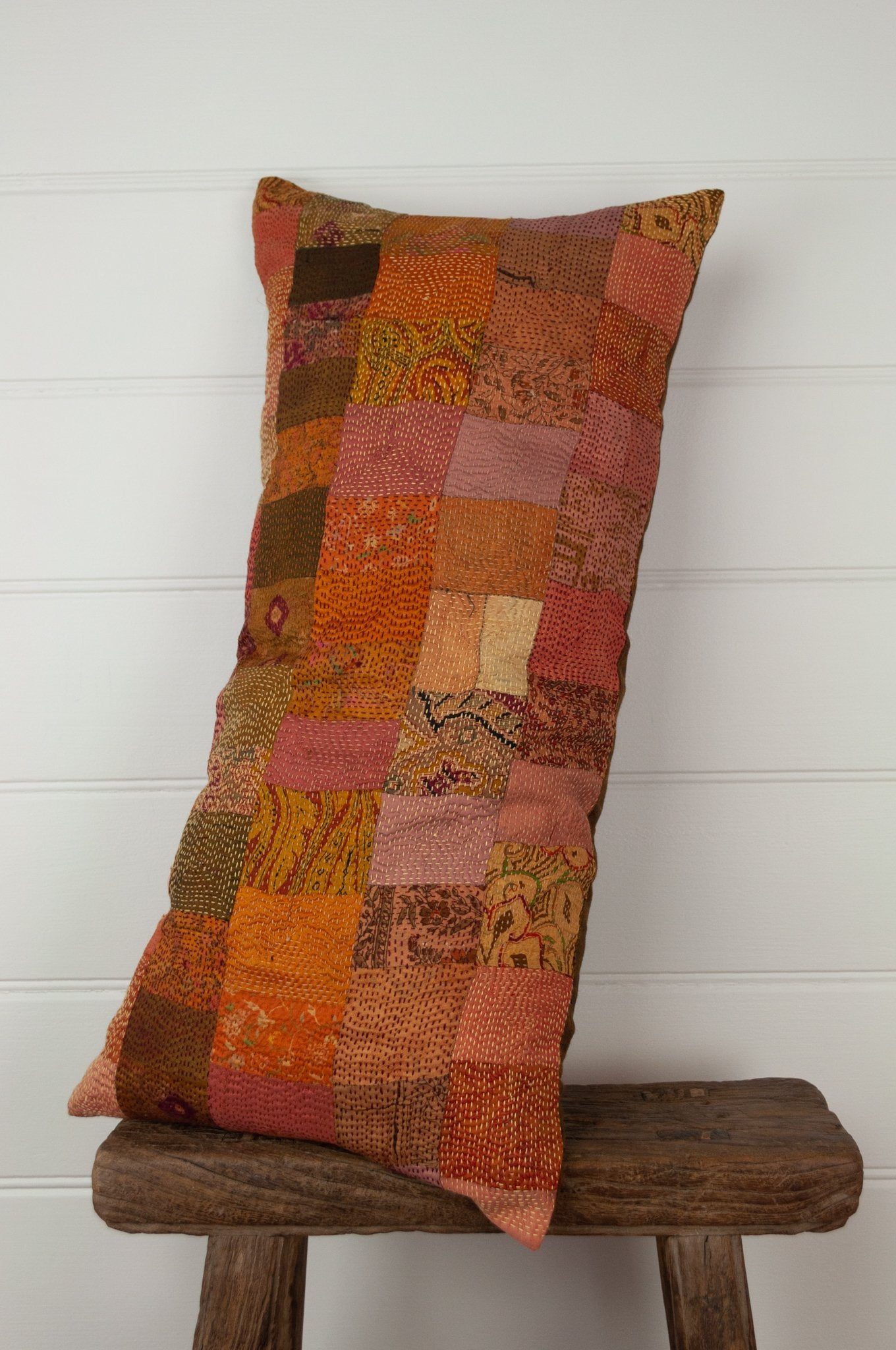 Vintage silk kantha bolster cushion, 30cmx60cm, in rich autumnal tones of orange, terracotta and vintage rose.