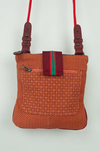 Anna Kaszer Nigi mini crossbody bag / pouch in smalt (red and orange check with burgundy accents and back). Close up.