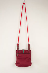 Anna Kaszer Nigi mini crossbody bag / pouch in smalt (red and orange check with burgundy accents and back). Rear view.