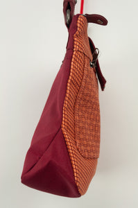 Anna Kaszer Nigi mini crossbody bag / pouch in smalt (red and orange check with burgundy accents and back). Side view.