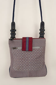 Anna Kaszer Nigi mini crossbody bag / pouch in smalt (blue check with burgundy accents and back). Close up.