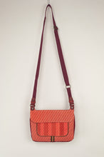 Load image into Gallery viewer, Anna Kaszer Nigi mini crossbody bag in tango (red and orange pattern with burgundy back), with adjustable shoulder strap.