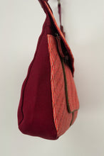 Load image into Gallery viewer, Anna Kaszer Nigi mini crossbody bag in tango (red and orange pattern with burgundy back), with adjustable shoulder strap. Side view.
