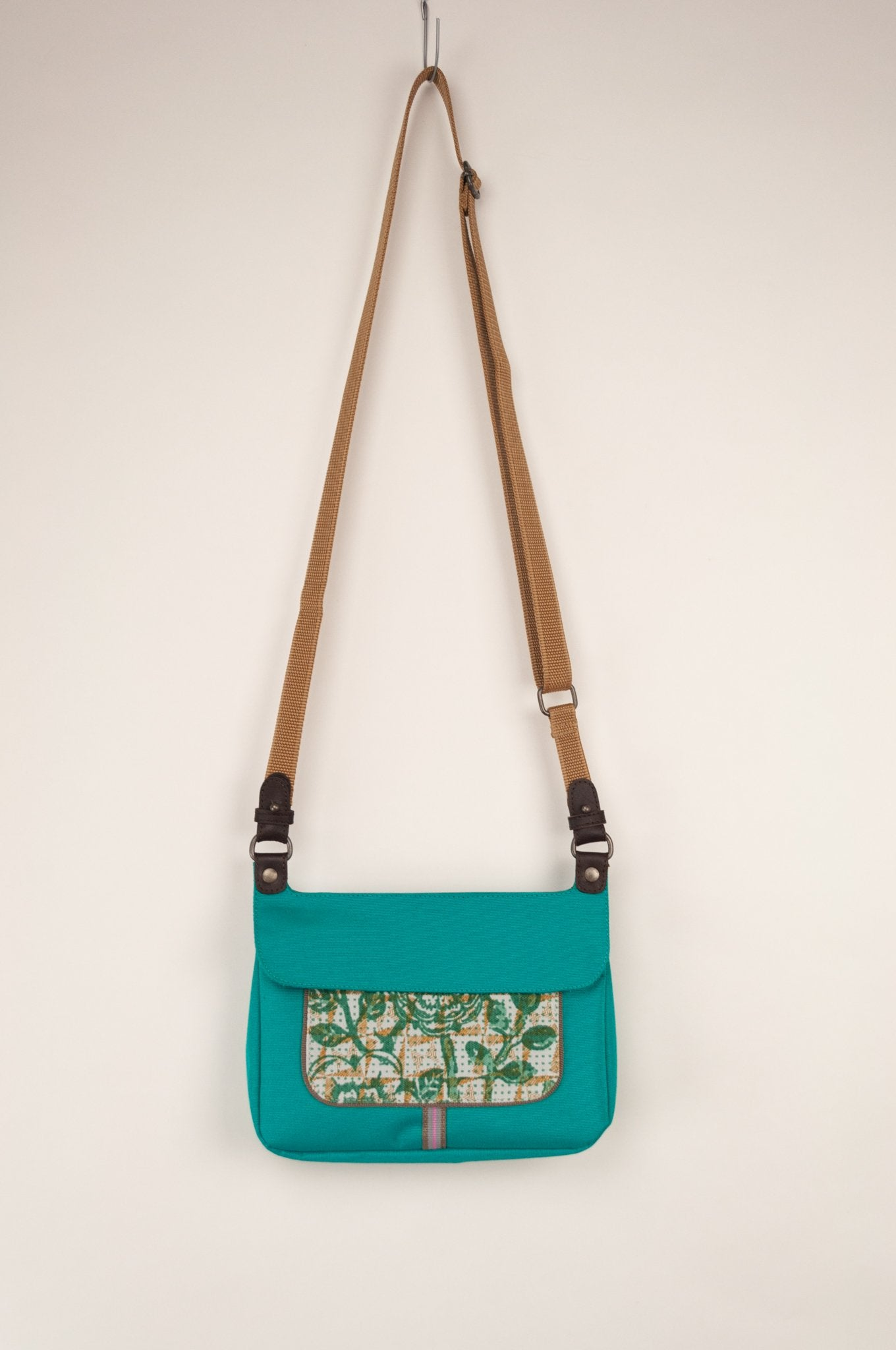 Anna Kaszer Nigi mini crossbody bag in nolana (floral pattern panel on turquoise), with adjustable shoulder strap.