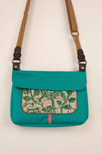 Load image into Gallery viewer, Anna Kaszer Nigi mini crossbody bag in nolana (floral pattern panel on turquoise), with adjustable shoulder strap. Close up.