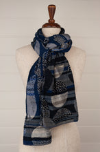 Load image into Gallery viewer, Létol French organic cotton scarf with a geometric design of stripes and overlaid dotted circles, in deep tones of indigo, navy blue, silver and charcoal.