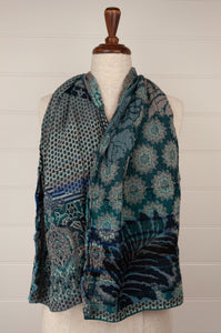 Létol French organic cotton scarf with a geometric and floral design in deep shades of turquoise, teal and cobalt blue.