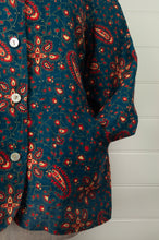 Load image into Gallery viewer, Dve Varuuni pure linen jacket, paisley print, shell buttons, patch pockets (close up).