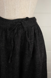 Dve Isha one size skirt in charcoal wool, elastic waist at back, adjustable tie at waist, side pockets (waist detail).