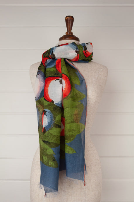 Fine cotton and silk blend French design Inouitoosh scarf, depicting an apple tree against a denim blue background, highlights of red, white and green.
