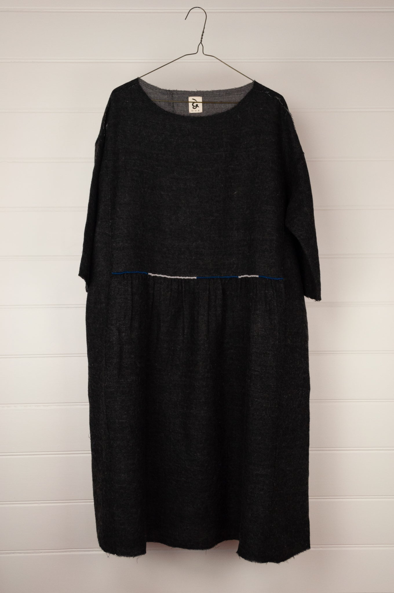 Dve 100% charcoal boiled wool, one size Padma dress, embroidered detail at gathered front waist panel, pockets and three quarter sleeves.