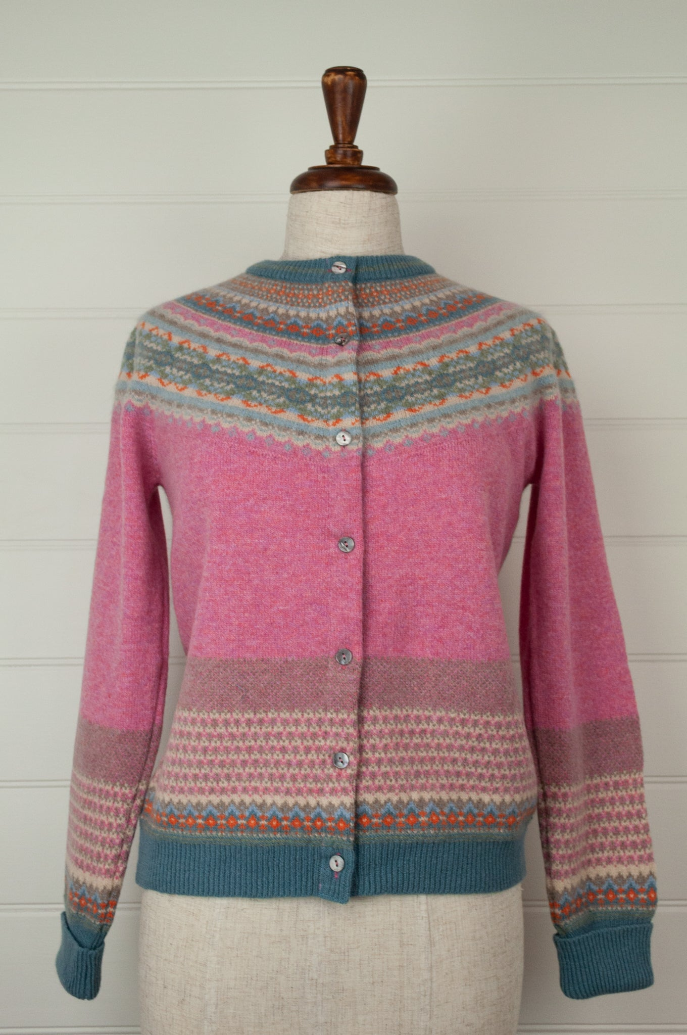 Made in Scotland, Eribé pure wool fairisle cardigan in Nougat, lolly pink with patterned yoke and trim in shades of light denim blue, orange, ecru and stone grey.