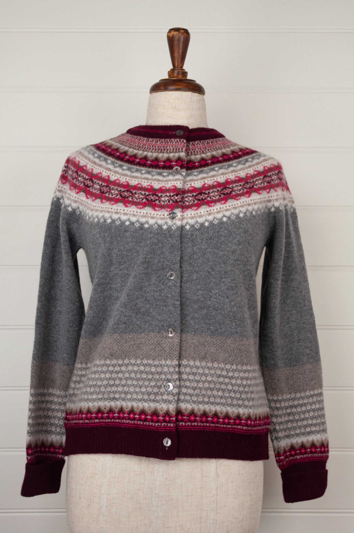 Made in Scotland, Eribé pure wool fairisle cardigan in Greyberry, soft charcoal with patterned yoke and trim in shades of rich berry reds and pinks, ecru and stone.