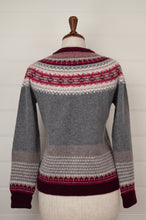 Load image into Gallery viewer, Made in Scotland, Eribé pure wool fairisle cardigan in Picalilli, soft charcoal with patterned yoke and trim in shades of rich berry reds and pinks, ecru and stone.