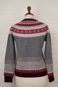 Made in Scotland, Eribé pure wool fairisle cardigan in Picalilli, soft charcoal with patterned yoke and trim in shades of rich berry reds and pinks, ecru and stone.