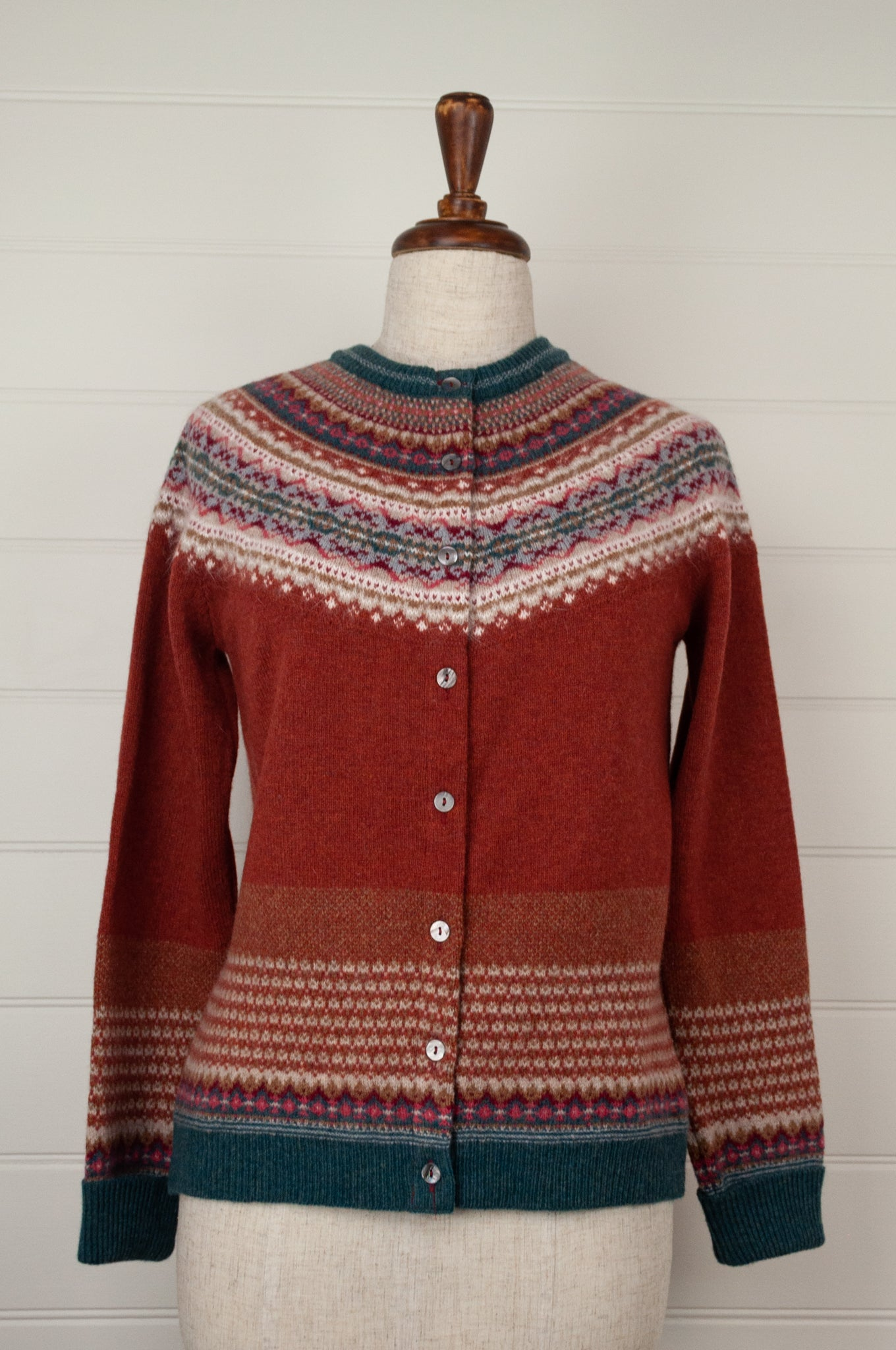 Made in Scotland, Eribé pure wool fairisle cardigan in Russet, rich red brown with patterned yoke and trim in shades of teal, toffee, burgundy, light grey and ecru.