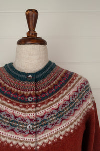 Made in Scotland, Eribé pure wool fairisle cardigan in Picalilli, lolly pink with patterned yoke and trim in shades of light denim blue, orange, ecru and stone grey.