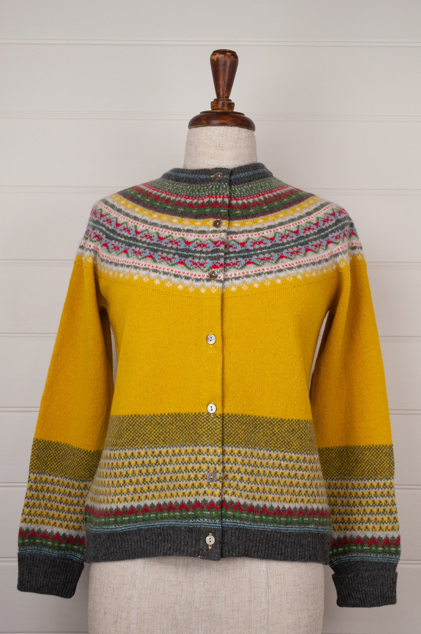 Made in Scotland, Eribé pure wool fairisle cardigan in Picalilli, golden mustard with patterned yoke and trim in vermilion red, leaf green, sky blue, white and charcoal.