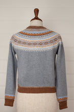 Load image into Gallery viewer, Made in Scotland, Eribé pure wool fairisle short cropped cardigan in Mirage, soft grey blue with patterned yoke and trim in shades of toffee brown, gold yellow, ecru and sky blue.