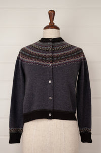 Made in Scotland, Eribé pure wool fairisle short cropped cardigan in Selkie, charcoal grey with patterned yoke and trim in shades of toffee brown, purple, sky blue and dark charcoal.