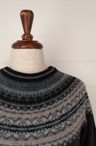 Made in Scotland, Eribé pure wool fairisle regular fit sweater  in Colliery, charcoal grey with patterned yoke and trim in shades of oatmeal, teal and soft blue greys and black.