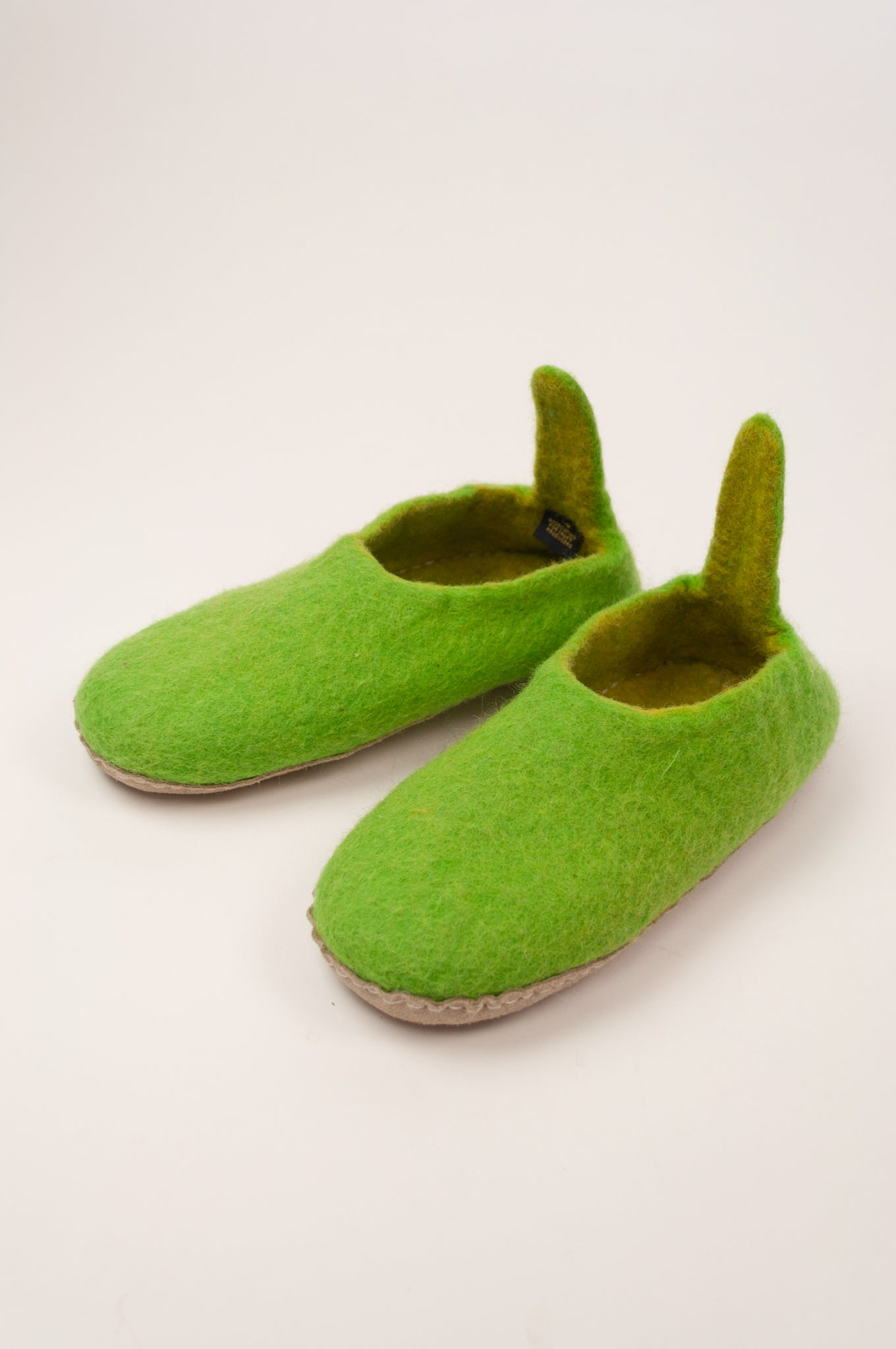 Fair trade pure wool felt slippers, pull on style with tab, in lime green.