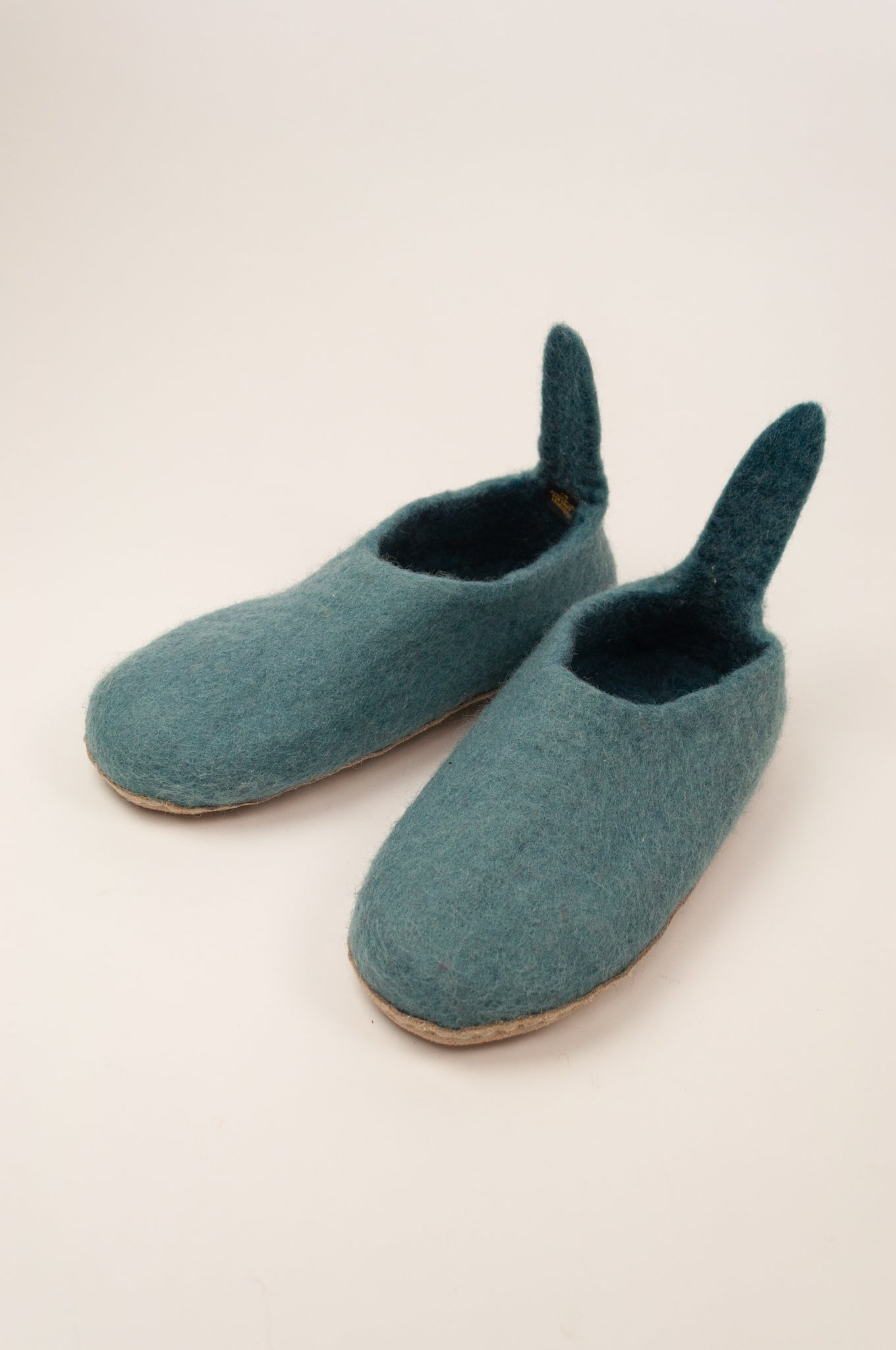Fair trade pure wool felt slippers, pull on style with tab, in blue.