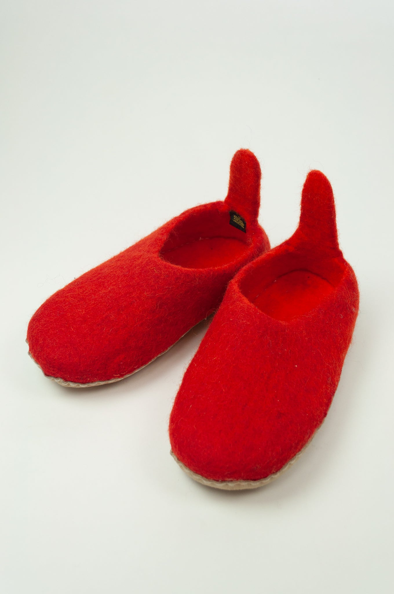 Fair trade pure wool felt slippers, pull on style with tab, in red.