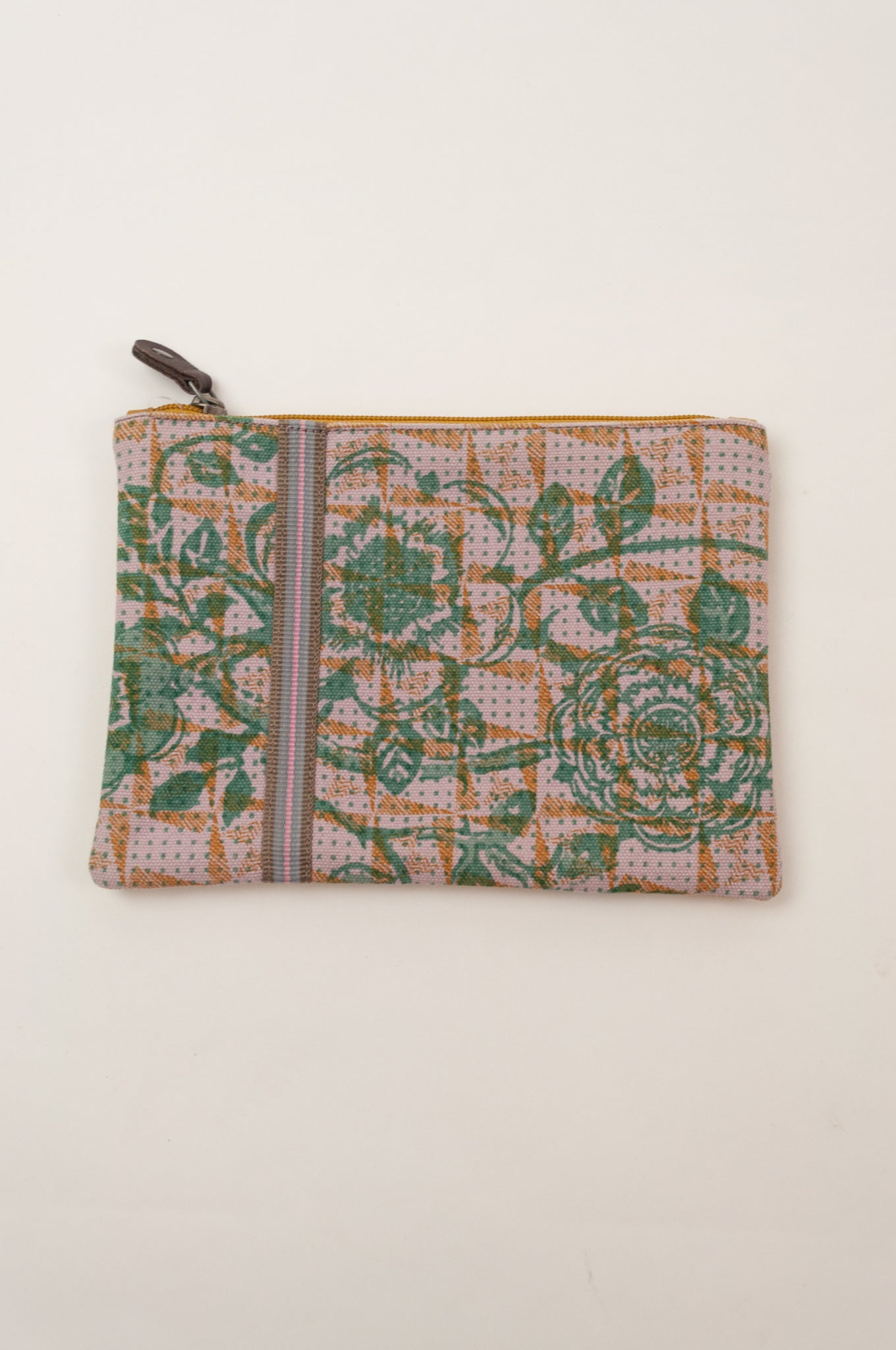 Anna Kaszer Polly pouch, geometric background in pink with yellow detail and green flower print.